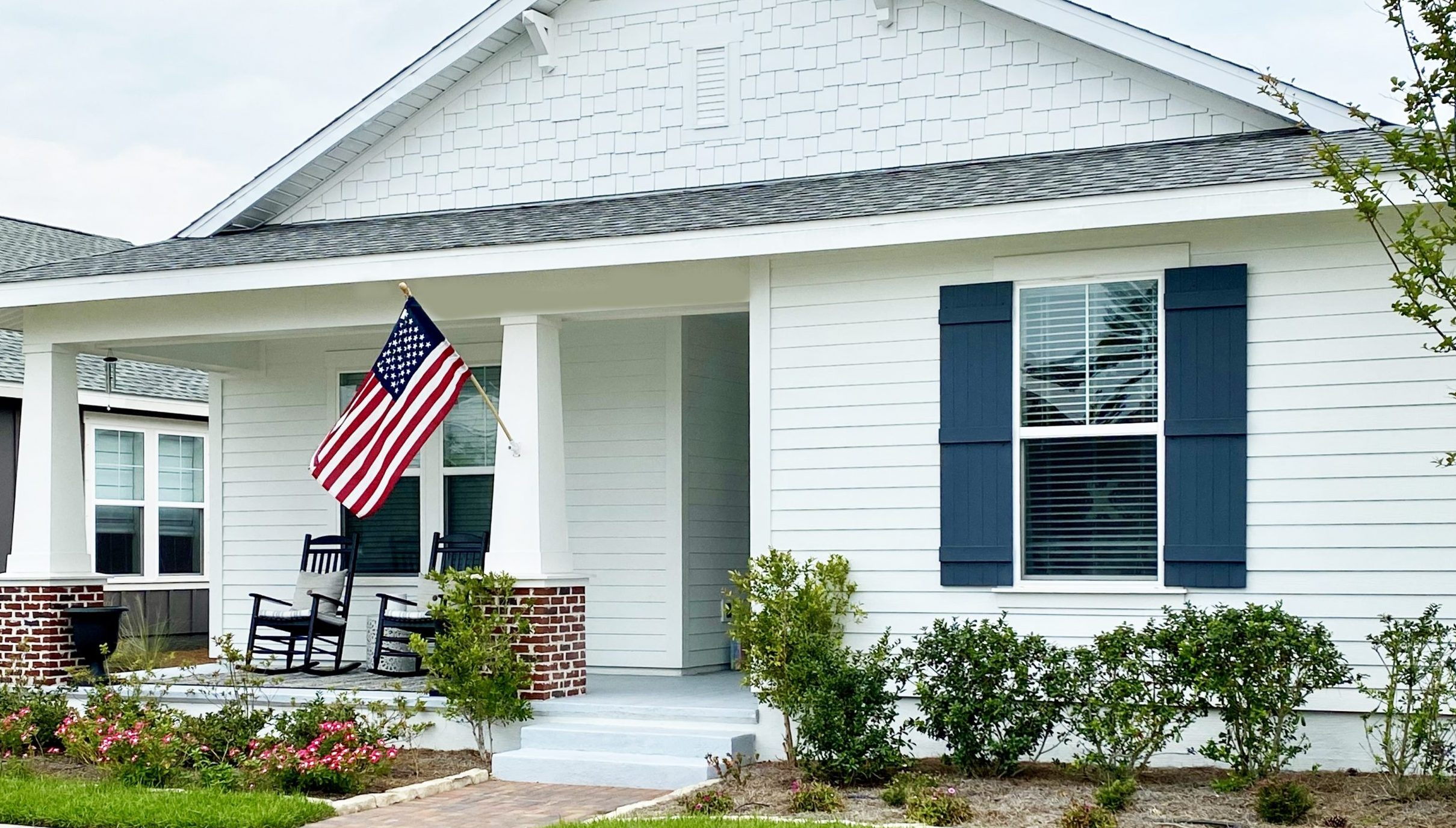 house with American flag out front